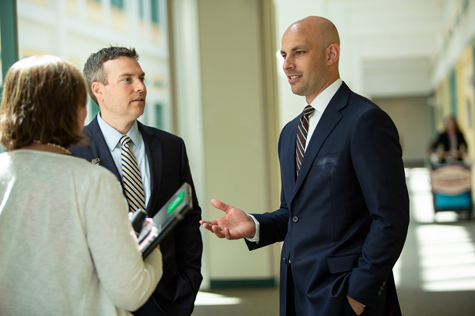 Brent Quimby (right) worked on the business proposal for a center for addiction medicine with his internship preceptor, Jason Lemire (left), practice manager for the Department of Orthopedics at Dartmouth-Hitchcock.