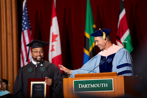 Jonathan Smith, MPH'18 receiving The Dartmouth Institute Leadership Award from Executive Director of Education Craig Westling.